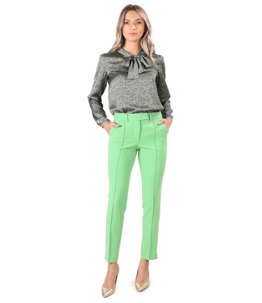 Elegant outfit with ankle pants and blouse with scarf collar